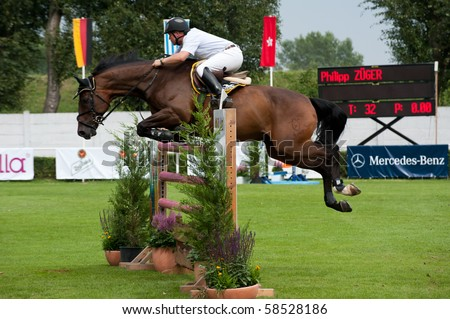BRATISLAVA, SLOVAKIA - AUGUST 5:  ZUGER Philipp on horse LIATOS II in ation during first round of qualification to Grand Prix CSIO-W*** August 5, 2010 in Bratislava, Slovakia - stock photo