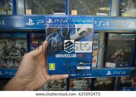 Bratislava, Slovakia, circa april 2017: Man holding Driveclub VR videogame on Sony Playstation 4 console in store