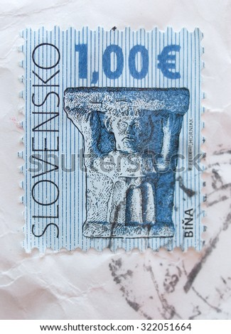 BRATISLAVA, SLOVAKIA - CIRCA DECEMBER 2013: mail stamp showing archaeological findings from the village of Bina, Slovakia - stock photo