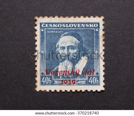 BRATISLAVA, SLOVAKIA - CIRCA MAY 2015: Jan Komensky mail postage from Czechoslovakia dating back to 1939 with red ink overprint Slovensky stat (Slovak country)  - stock photo