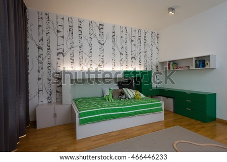 BRATISLAVA, SLOVAKIA - JUL 19, 2016: Interior of kids play room with bed and toys created by young interior designers from Kivvi architects based in Bratislava, Slovakia