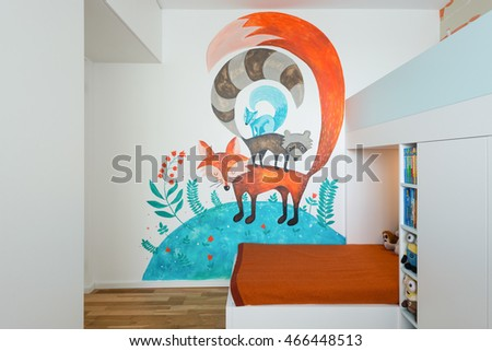 BRATISLAVA, SLOVAKIA - JUL 19, 2016: Interior of small kids play room with bed created by young interior designers from Kivvi architects based in Bratislava, Slovakia