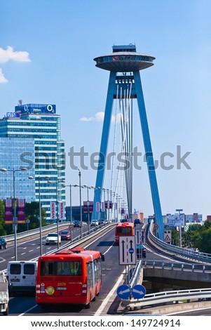 BRATISLAVA, SLOVAKIA - JULY 23. New Bridge over Danube River in Bratislava,  on July 23, 2013 in Slovakia. Bratislava is the capital of Slovakia on Danube River  - stock photo