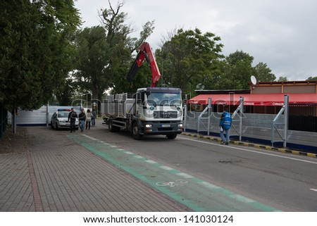 BRATISLAVA, SLOVAKIA - JUNE 4:  Flood barricades are prepared to be erected on the Petrzalka side of the Danube on June 4, 2013 in Bratislava - stock photo
