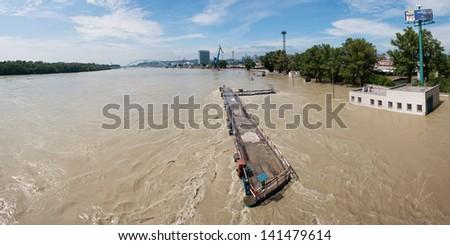 BRATISLAVA, SLOVAKIA - JUNE 6:  Panoramic view of high water on the Danube river from the Port Bridge on June 6, 2013 in Bratislava - stock photo