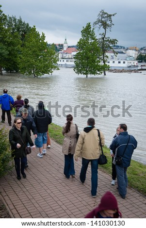 BRATISLAVA, SLOVAKIA - JUNE 4:  People watch as water level of the Danube river is rising on the Petrzalka side of the Danube on June 4, 2013 in Bratislava - stock photo