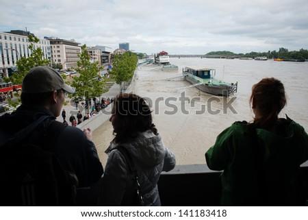 BRATISLAVA, SLOVAKIA - JUNE 5:  People watch as water of the Danube river is rising on June 5, 2013 in Bratislava - stock photo