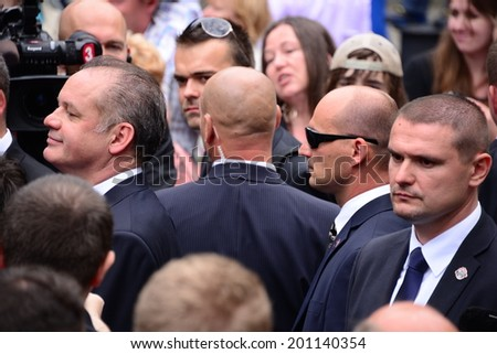 BRATISLAVA, SLOVAKIA - JUNE 15, 2014 President Andrej Kiska surrounded by bodyguards during the inauguration of Andrej Kiska on June 15, 2014 in Bratislava, Slovakia. - stock photo