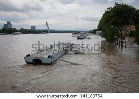 BRATISLAVA, SLOVAKIA - JUNE 5:  Rising water level of of the Danube river on Vajanskeho Embankment on June 5, 2013 in Bratislava - stock photo