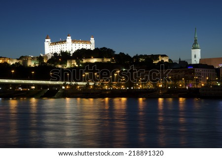 BRATISLAVA, SLOVAKIA - JUNE 09, 2014: The night view of Bratislava castle, the cathedral and the Most SNP bridge on Danube with the exposition of photographs. - stock photo