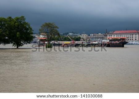 BRATISLAVA, SLOVAKIA - JUNE 4:  The water flooded whole Tyrsovo Embankment on the Petrzalka side of the Danube on June 4, 2013 in Bratislava - stock photo
