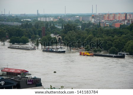 BRATISLAVA, SLOVAKIA - JUNE 5:  Tyrsovo Embankment on the Petrzalka side with rising water of Danube river  - view from Bratislava castle on June 5, 2013 in Bratislava - stock photo