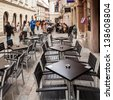 BRATISLAVA, SLOVAKIA - MAY 8: Empty bar in the Panska street in Old Town on May 8, 2013 in Bratislava, Slovakia. Bratislava is the most populous (462,000) and most visited city in Slovakia. - stock photo