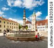 BRATISLAVA, SLOVAKIA - MAY 8: Tourists and residents on Main City Square in Old Town on May 8, 2013 in Bratislava, Slovakia. Populated by 462,000 people, the capital is the largest city in Slovakia. - stock photo