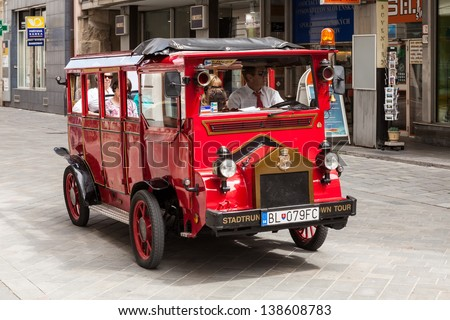 BRATISLAVA, SLOVAKIA - MAY 9: Tourists in a bus on the streets in Old Town on May 9, 2013 in Bratislava, Slovakia. Bratislava is the most populous (462,000) and most visited city in Slovakia.