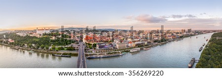Bratislava, Slovakia - Panoramic View with the Castle, Old Town and Danube River at Sunset as Seen from Observation Deck - stock photo