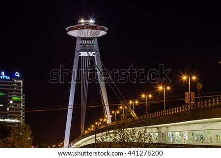 BRATISLAVA, SLOVAKIA - 29TH APRIL 2016: The UFO Tower and Novy Most Bridge at night. The UFO Tower offers high views of the city, - stock photo