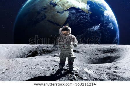 Brave astronaut at the spacewalk on the moon. This image elements furnished by NASA. - stock photo