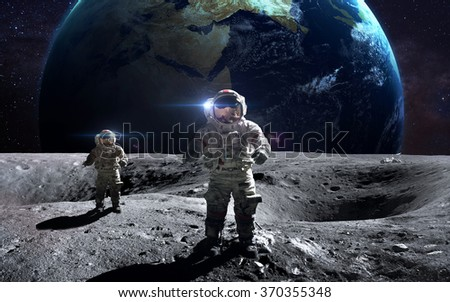 Brave astronauts at the spacewalk on the moon. This image elements furnished by NASA. - stock photo