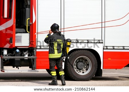 brave firefighter with oxygen tank in action 1 - stock photo