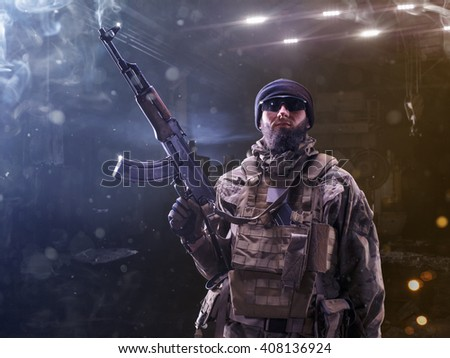 Brave special forces soldier is posing on camera - stock photo