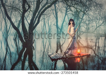 Brave woman in fairy forest foggy floats on a raft with a lantern. Alone girl looking for a way in the dark. - stock photo