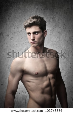Brawny bare-chested handsome young man - stock photo