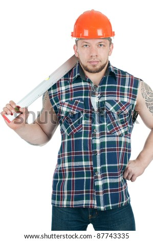 Brawny building contractor in work shirt and hardhat holding a level in his hands, white background