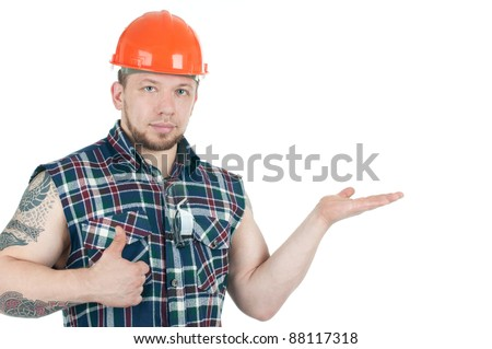 Brawny tattooed construction worker in sleeveless shirt and hardhat, isolated over a white background, copyspace - stock photo