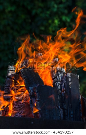 Brazier with burning coals on deep green background