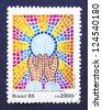 BRAZIL � CIRCA 1985: a postage stamp printed in Brazil commemorative of the 11 Eucharistic National Congress, circa 1985. - stock photo