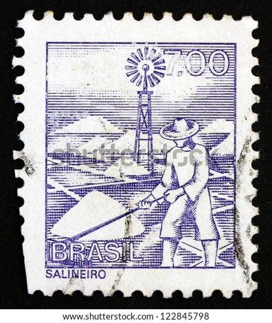 BRAZIL - CIRCA 1977: a stamp printed in the Brazil shows Salt Mine Worker, circa 1977 - stock photo