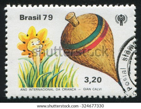 BRAZIL - CIRCA 1979: stamp printed by Brazil, shows  Emblem and Toys, circa 1979 - stock photo