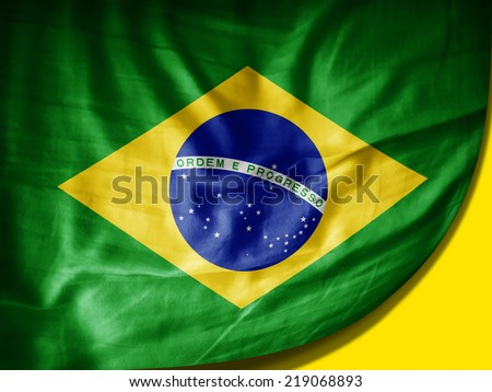 Brazil flag and yellow background