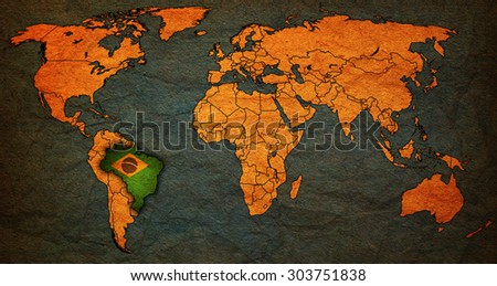 brazil flag on old vintage world map with national borders - stock photo