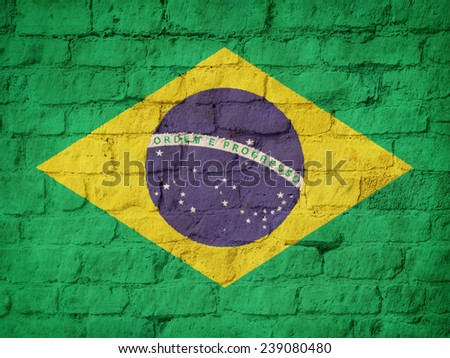 Brazil flag painted on brick wall background - stock photo