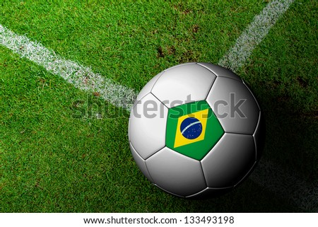 Brazil Flag Pattern of a soccer ball in green grass - stock photo