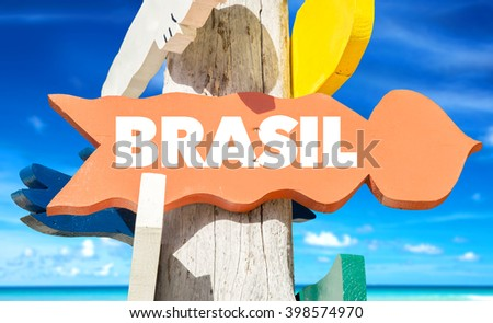 Brazil (in Portuguese) signpost with beach background - stock photo