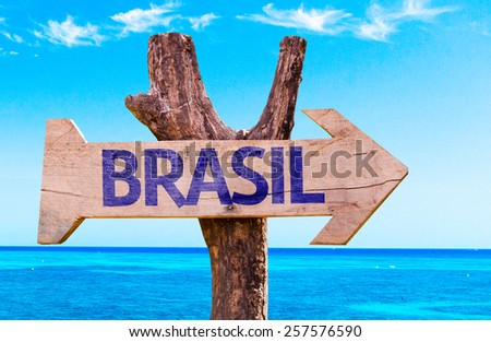 Brazil (in Portuguese) wooden sign with a beach on background - stock photo