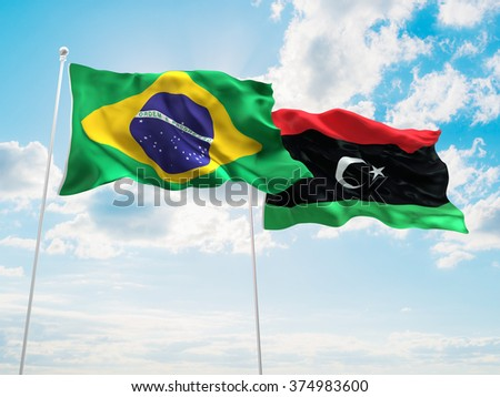 Brazil & Libya Flags are waving in the sky - stock photo