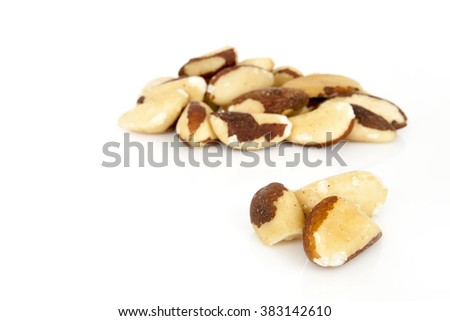 Brazil nut on a white background (Bertholletia excelsa), blanched close up isolated on the white background