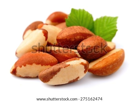 Brazil nuts with leafs on white close up. Bertholletia. - stock photo