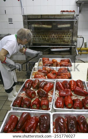 Brazil, Sao Paulo, August 31, 2007: woman cooking red peppers stuffed in the feast of Our Lady Achiropita in the neighborhood of Bixiga in Sao Paulo