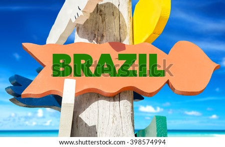 Brazil signpost with beach background - stock photo