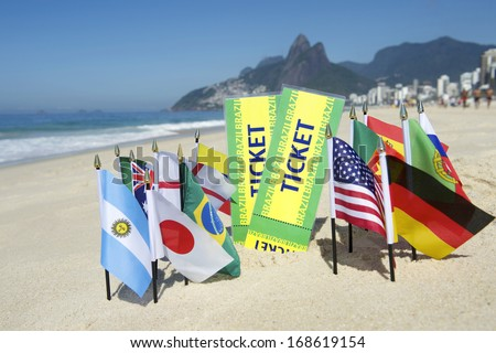 Brazil tickets with international world flags on the beach in Rio de Janeiro