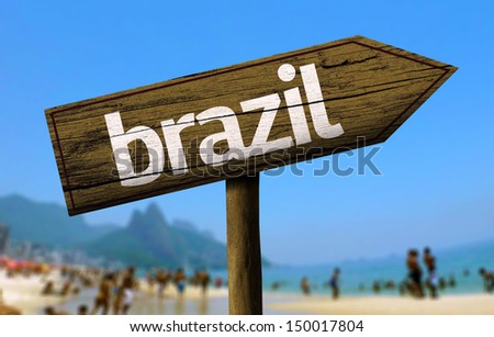Brazil wooden sign with a beach on background - stock photo