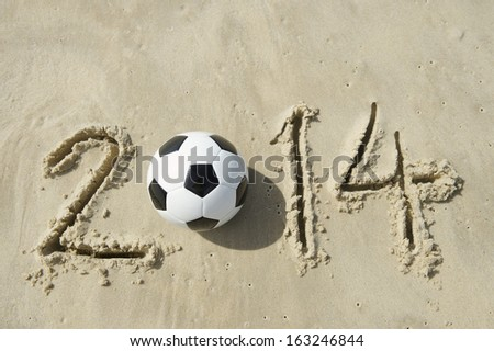 Brazil 2014 World Cup message with football soccer ball on beach in Rio - stock photo
