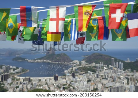 Brazilian and international flags bunting decoration above scenic overlook of Rio de Janeiro Brazil with Sugarloaf Pao de Acucar Mountain  - stock photo