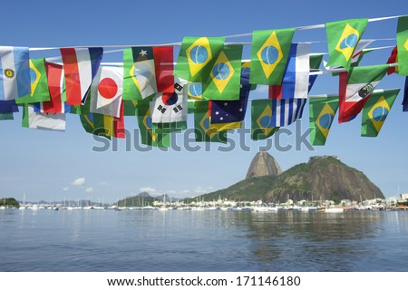 Brazilian and international flags bunting decoration above Sugarloaf Mountain Rio de Janeiro scenic sea view Brazil - stock photo