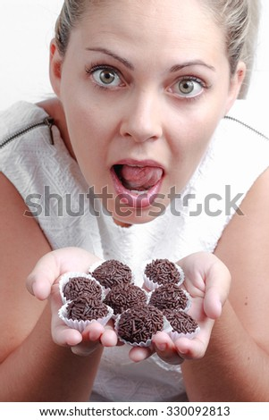 Brazilian beautiful woman with funny expression showing a lot of brigadeiros